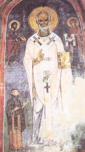 Святой Николай. Слева и справа от него – Христос и Богородица. Внизу слева изображен ктитор.